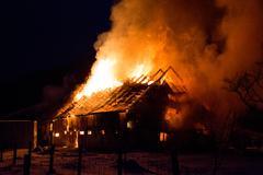 Blazing fire destroyed barn Stock Photos