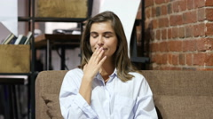 Yawing Sleepy Tired Young Lovely Girl Sitting on Sofa Stock Footage