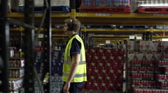 Man locating stock in a warehouse, side view, shot on R3D Stock Footage