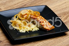 Grilled salmon with burned onion and couscous Stock Photos