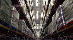 Moving along an aisle in a storage warehouse, shot on R3D Stock Footage