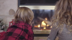 Little Kids Watch Fire Burn In Fireplace, Backs To Camera Stock Footage