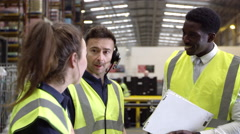 Casual conversation between staff in warehouse, shot on R3D Stock Footage
