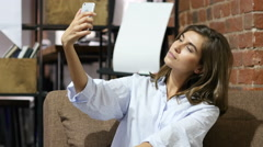 Sitting Beautiful Lovely Girl Taking Selfie with Smartphone Stock Footage