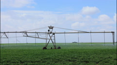 T-L  of a center pivot irrigation system as it waters peanuts in Texas, 4K Stock Footage