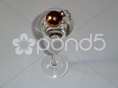 Gold bauble in champagne glass Stock Photos