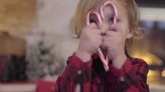 Cute Little Boy Makes A Heart Shape With Two Candy Canes, He Peeks Through It Stock Footage