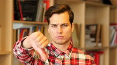 Thumbs Down by Unsatisfied  Young Man Indoor Stock Footage