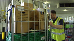 Warehouse manager inspects goods for delivery, shot on R3D Stock Footage