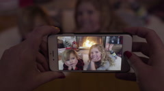 Mom Takes Video Of Kids By Fire On Christmas, Boy Looks Bored, His Sister Smiles Stock Footage