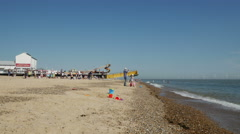 Tourist boat full of tourists beaching at Great Yarmouth Stock Footage