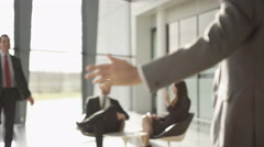 4K 2 Businessmen who are old friends greet each other in modern office building Stock Footage