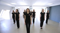 In model school females are repeating dance movements Stock Footage