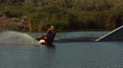 Slow motion shot of man wakeboarding Stock Footage
