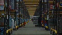 Defocussed activity in warehouse pulls into focus, shot on R3D Stock Footage