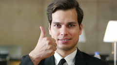 Thumbs Up by Businessman, Portrait in Office Stock Footage