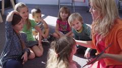 Kids looking at digital tablet in pre-school classroom - 4K Stock Footage