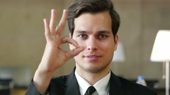 Okay Gesture by Satisfied Successful Businessman in Office Stock Footage