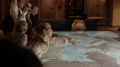 Pupils On School Trip To Museum Looking At Map Shot On R3D Stock Footage