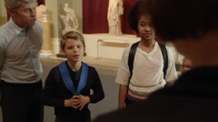 Pupils On School Field Trip To Museum With Guide Shot On R3D Stock Footage