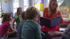 Teacher and little children at pre-school - 4K Stock Footage