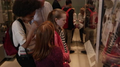Students Look At Objects In Cases On Museum Trip Shot On R3D Stock Footage