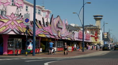Tourists and Visitors walking along the Golden Mile Seafront at Great Yarmouth Stock Footage
