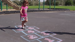 Little girl playing hopscotch at pre-school - 4K Stock Footage