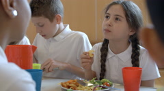 Close Up Of School Pupil Having Lunch In Canteen Shot On R3D Stock Footage