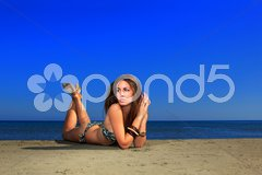 Beautiful girl on the beach Stock Photos