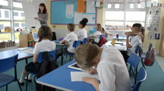 School Pupils In Maths Class With Teacher Shot On R3D Stock Footage