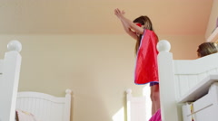 Young girls dressed as superheroes playing at home - 4K Stock Footage
