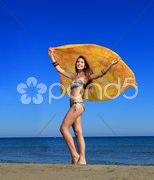 Happy woman with sarong Stock Photos