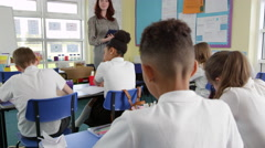 Teacher With Digital Tablet Teaching Class Shot On R3D Stock Footage