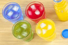 Above shot of four glasses with different flavour drinks Stock Photos