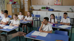 Pupils In Class With Teacher Answering Question Shot On R3D Stock Footage