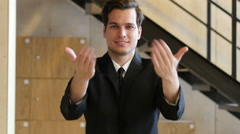 Inviting Gesture by Young Man in Suit Stock Footage