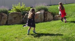 Young girls dressed as superheroes playing outside - 4K Stock Footage