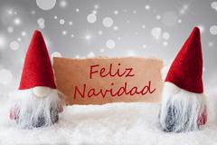 Red Gnomes With Snow, Feliz Navidad Means Merry Christmas Stock Photos