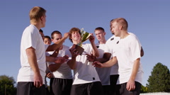 High school boys playing soccer in the park - 4K Stock Footage