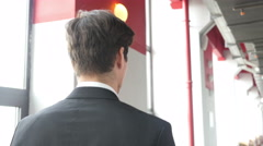 Walking Young Man in Suit  in Corridor of Office, Back View Stock Footage