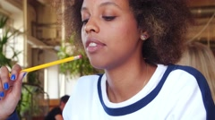 Portret young alone black woman student overwhelmed by her homework in cafe. At Stock Footage