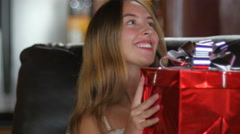 An adorable young woman receives a gift and smiles and says thank you Stock Footage