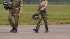 Fighter Pilots walking on tarmac Stock Footage