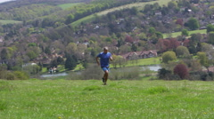 Mature Man Jogging In Countryside Shot On R3D Stock Footage