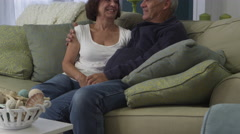 Middle aged couple sitting in their beach house - 4K Stock Footage