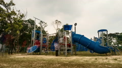 Time Lapse - Kids and adults playing at a playground during a hazy morning. Stock Footage