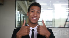 Thumbs Up by Black Businessman in Suit in Office Stock Footage