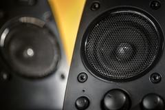 Audio speakers on yellow background Kuvituskuvat