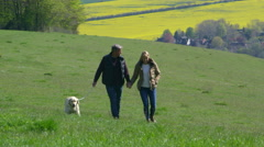 Mature Couple Taking Golden Retriever For Walk Shot On R3D Stock Footage